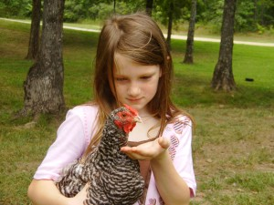Mary holding a Dominique hen