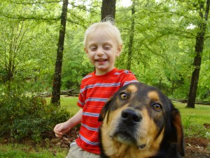 3 year old Benjamin with Rex in our front yard