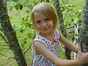 4 year old Beth in the Bradford pear tree in our front yard